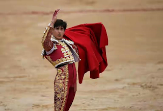 Bullfighter get up after being gored at the Pamplona bullfighting Festival