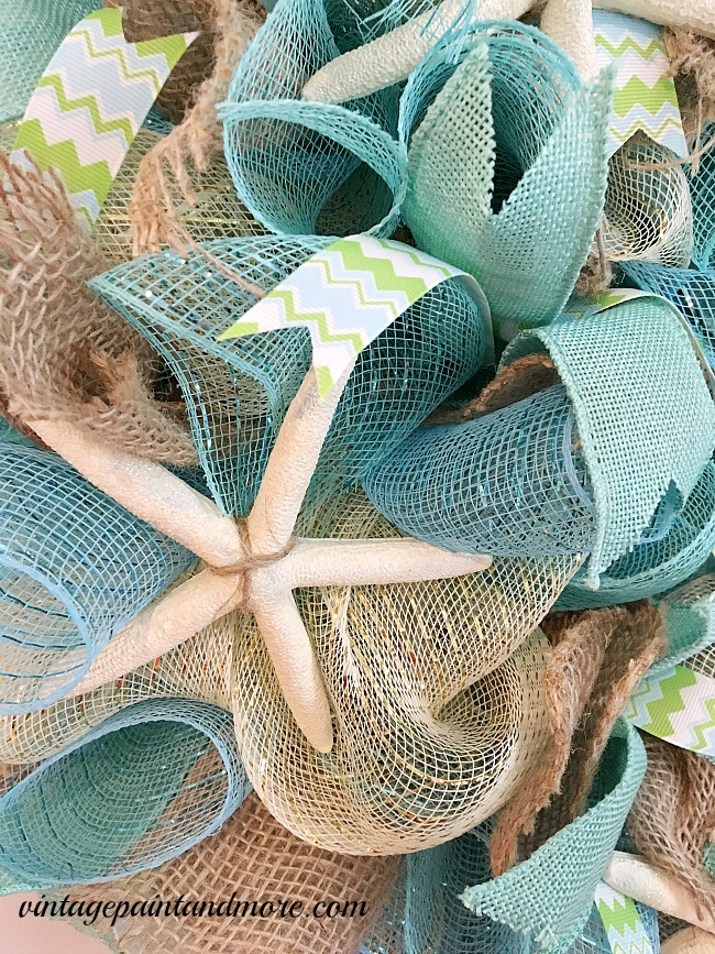Vintage Paint and more... a beach themed wreath made with deco mesh, burlap ribbons, chevron ribbon and ceramic starfish
