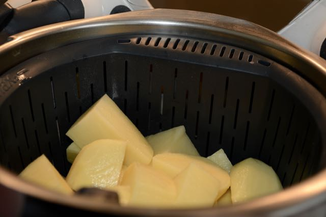 Potatoes being cooked in the steamer basket