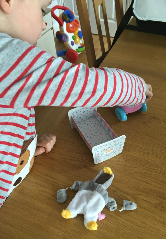 boy-playing-with-Tinsy-winsy-weeny-tot-doll-and-pram