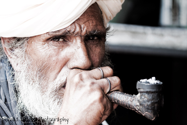 indian guy with turban smoking pipe