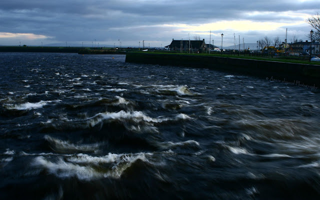 the view from Wolfe Tone Bridge over the river Corrib meeting the ocean, Galway