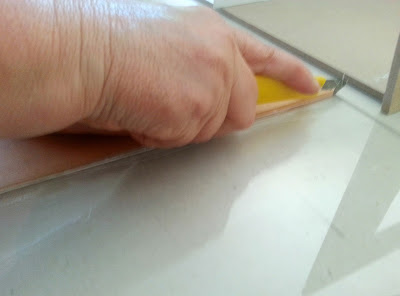 Cutting a piece of perspex with a p-cutter.
