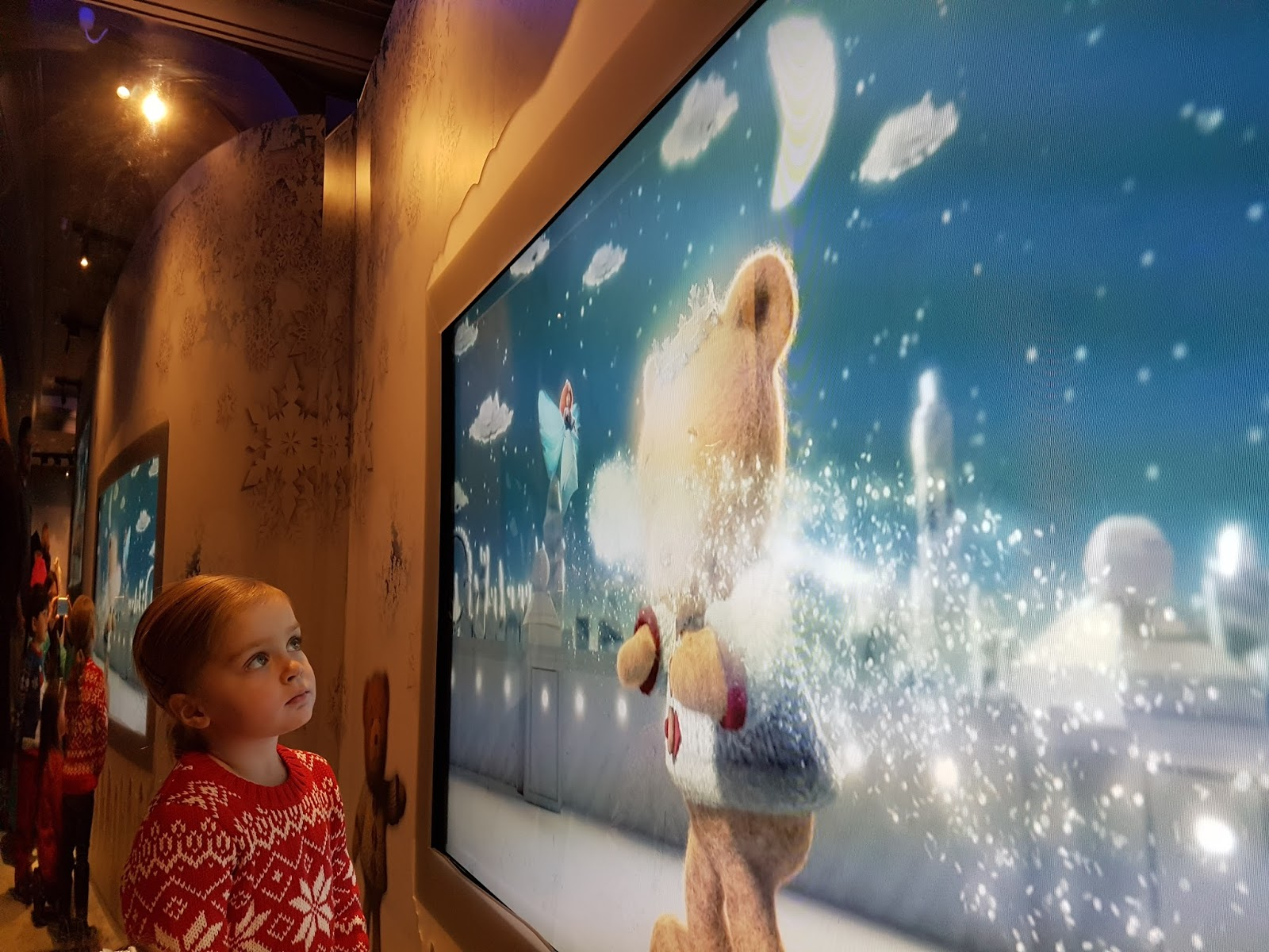 girl watching harrods animation film at harrods christmas grotto 2016