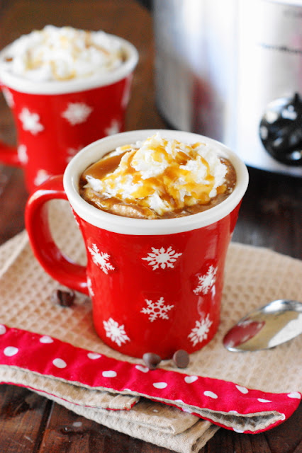 Slow Cooker Caramel Hot Chocolate - with its wonderful flavor & slow cooker ease and convenience, it's the perfect thing to serve for your crowd.  www.thekitchenismyplayground.com