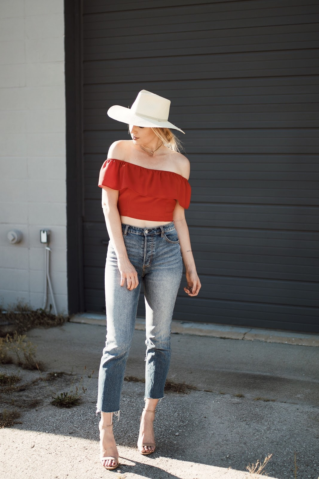 summertime outfit: high-waisted jeans, off the shoulder top, wide brim hat
