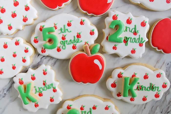 the CUTEST back-to-school apple decorated cookies