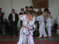 Image of young Judo player demonstrating in front of and audience