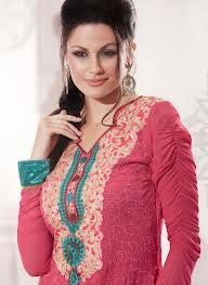 a woman wearing a latest fashion designer red salwar kameez for ladies