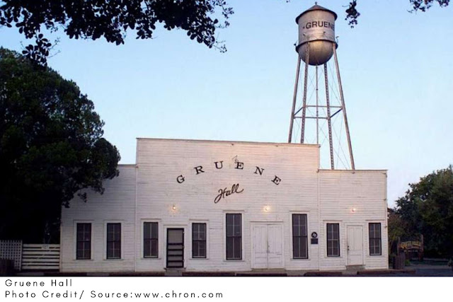 the white face and water tower of the Gruene Hall