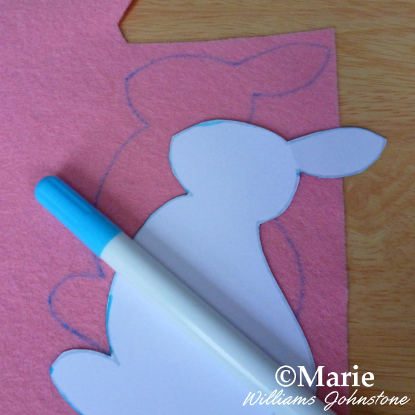 Tracing around the free pattern to create a pink felt Easter bunny rabbit motif