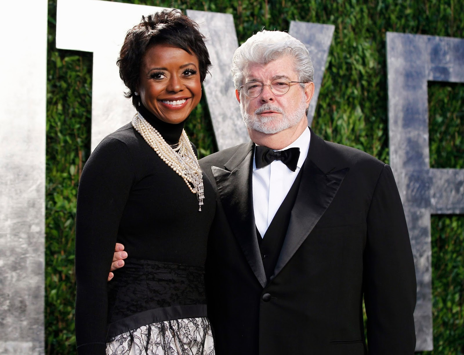 director george lucas and his partner mellody hobson arrive at the 2012 vanity fair oscar party in west hollywood california in this february 26 2012 file photo lucas has become engaged to his lon