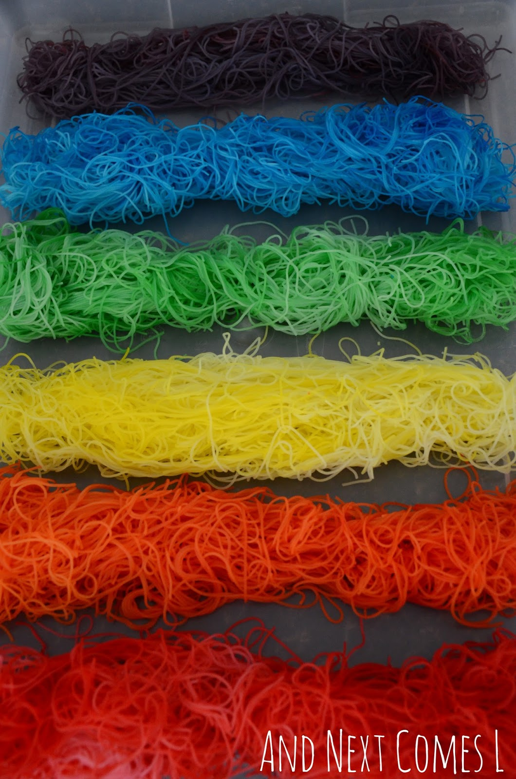 Rainbow rice noodles sensory bin for kids from And Next Comes L