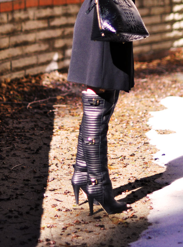 over the knee leather boots with gold buckles