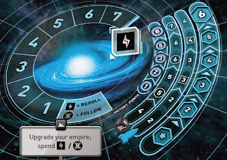The player mat. On the left is an image of a galaxy. Surrounding that is a circular track with spaces numbered from 1 to 7. There is a space with the energy icon, which resembles a lightning bolt, and another space with the energy icon labelled as 'reroll' and the culture icon, which resembles a greek column, labelled 'follow.' Below that is a box labelled with the 'utilize a colony' icon, which says 'Upgrade your empire; spend [energy icon] / [culture icon].' Along the right side of the mat are four tracks, running in concentric arcs. The outhermost has six spaces; the first has a star icon, the rest are numbered 2 through 6. The next track inward (to the left) is labelled with a rocket ship icon. There are six spaces here as well, each one is placed even with the spaces in the first track. The first two spaces are numbered 2; the next two are numbered 3 (the first of these two spaces has a box around the 3), and the last two are labelled 4 (the first of these two spaces has a box around the 4 as well). The next track inward is labelled with an image of the special dice used in the game. There are six spaces here as well, each also even with the spaces from the other two tracks. The first space is labelled with a 4, the second and third with a 5 (the first five is in a circle), the fourth and fifth with a 6 (the first of which is also in a circle), and the sixth has a 7 in a circle. The last track is shorter; it only has five spaces, which are even with the second through sixth spaces of the other three tracks. This track is labelled 'Victory Points,' and is numbered 1, 2, 3, 4, 5, and 8 (no, not 6).
