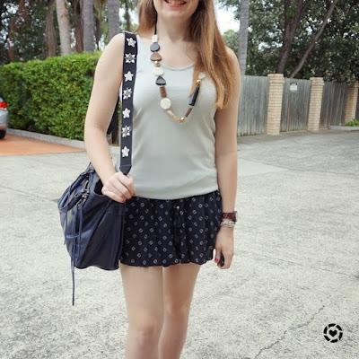 awayfromtheblue instagram rebecca minkoff regan bag and embellished guitar strap with metallic tank soft shorts