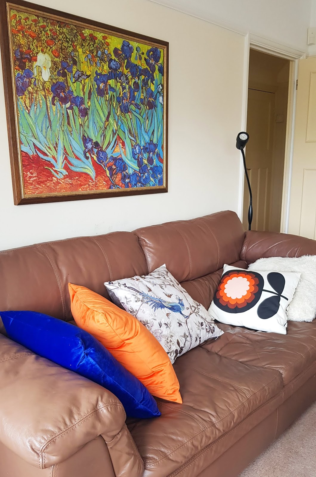 Van Gogh Irises painting with cushions picking out the blue and orange tones