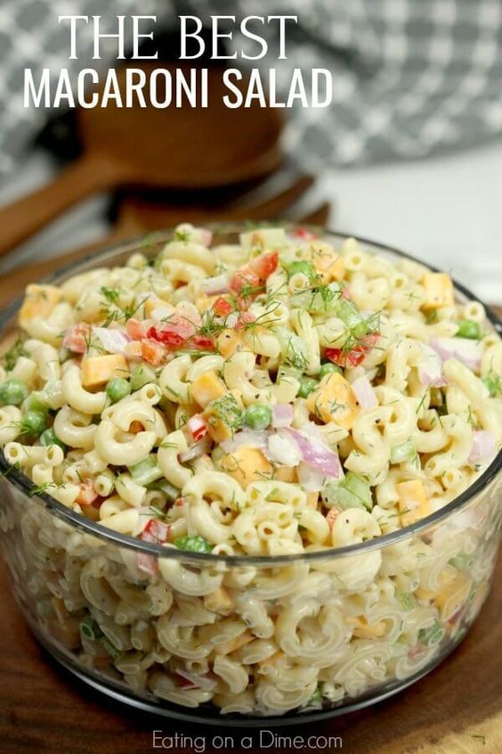 This Easy Macaroni Salad recipe is the perfect side dish to bring to Summer BBQ's, parties and more! Easy macaroni salad is loaded with veggies, cheese and more. You will love the creamy dressing.