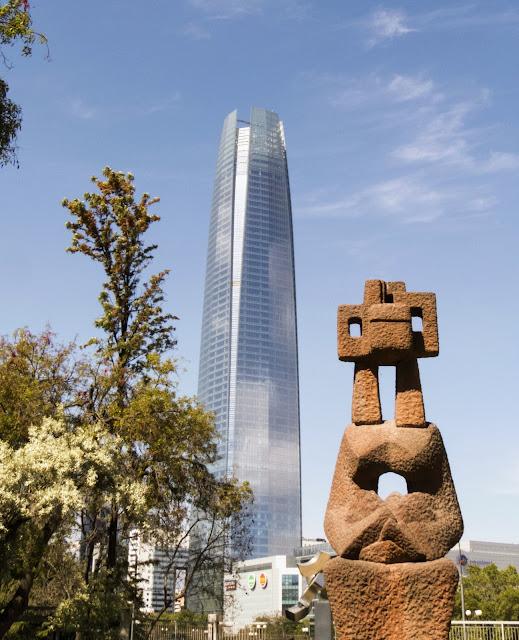 Sculpture and a skyscraper in Santiago Chile