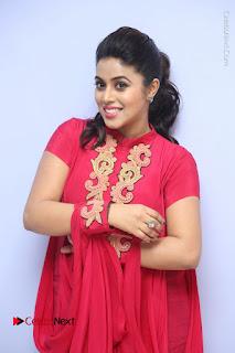 Actress Poorna Latest Stills in Red Dress at Rakshasi First Look Launch  0100.JPG