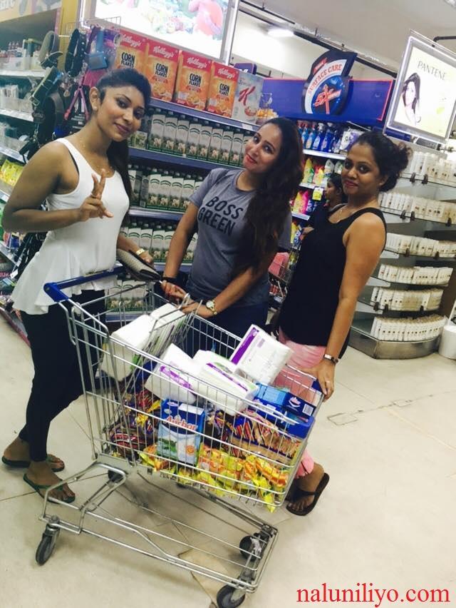 Piumi Hansamali Nipuni Wilson shopping donations to help flood affected people