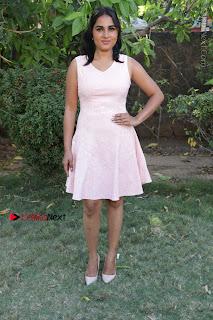 Actress Srushti Dange Stills in Short Dress at Mupparimanam Press Meet  0035.jpg