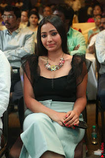 Swetha Basu in a Black Sleeveless Top Long Skirt at Mixture Potlam Movie Audio Launch 064.JPG