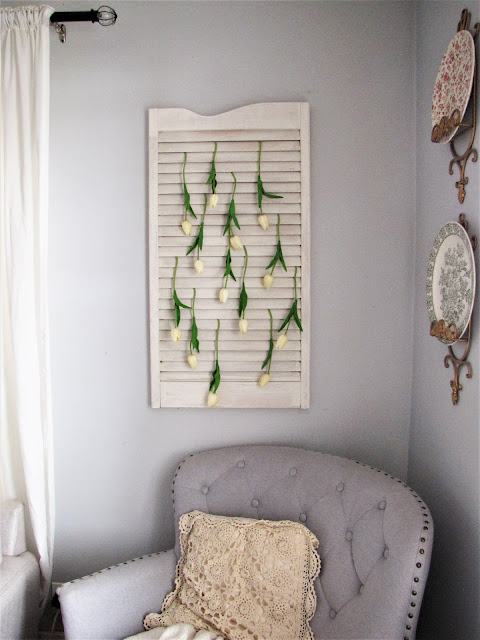 flowers hanging on a shutter as wall decor