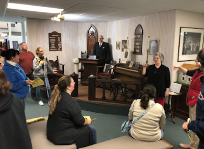 The SEJ group learning about Bishop Moore, his wax figure, and some of the history at Epworth by the Sea.