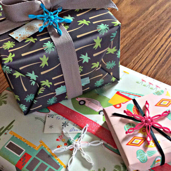 palm trees, palm springs houses, and retro Christmas ornaments printed gift wrap