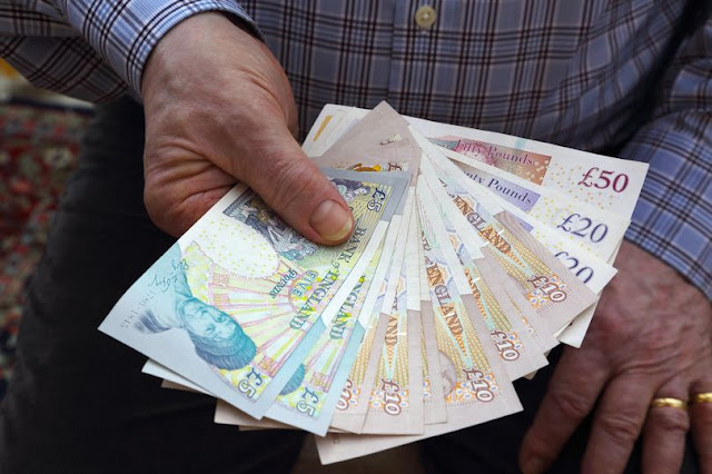 Cleaner finds more than £300,000 cash in brown envelope on London bus and hands it to police