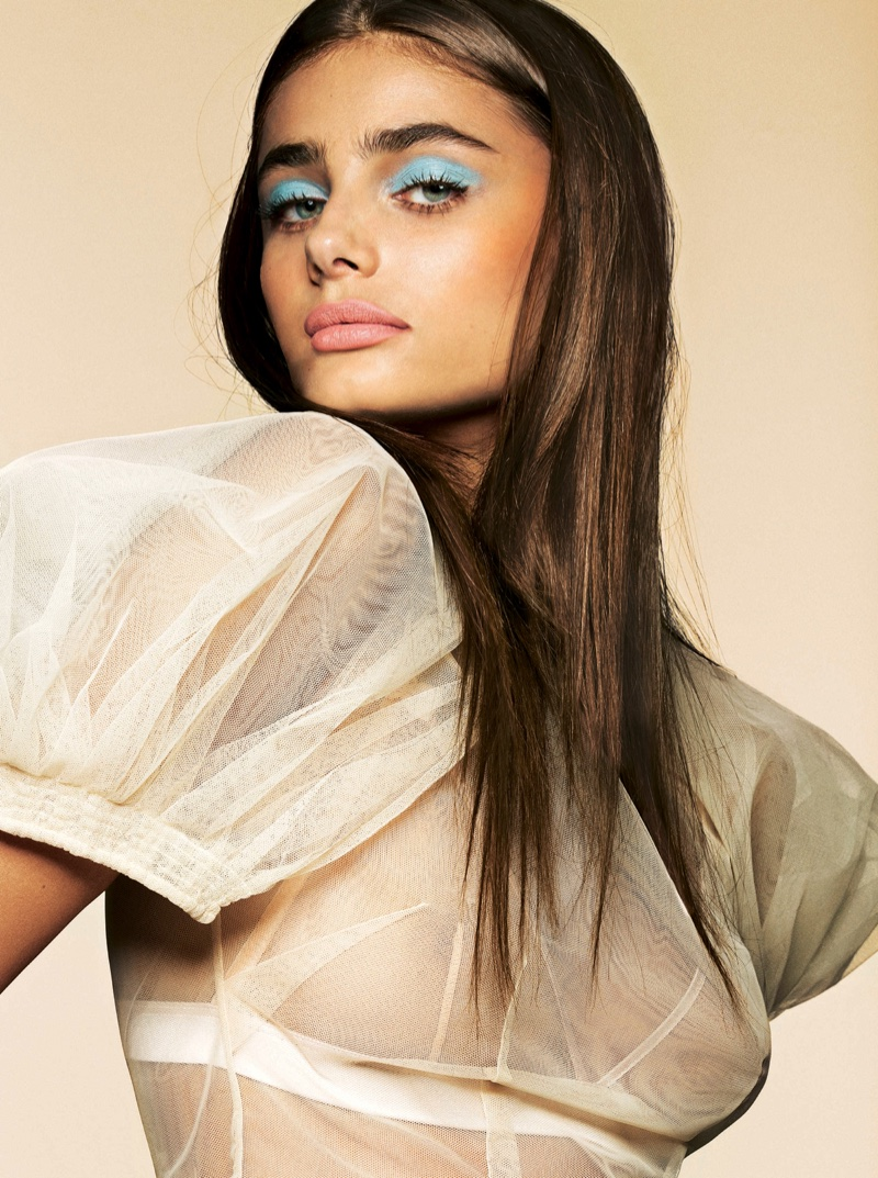 Taylor Hill wears Simone Rocha blouse with blue eyeshadow and pink lip color from Lancome