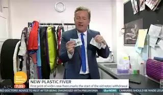 Good morning Britain presenter Piers Morgan tears new £5 pound note illegally