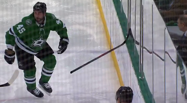 Roman Polak gets stick stuck in glass