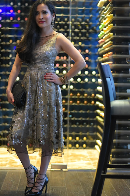 Joanna Joy Fashion Blogger A Stylish Love Story Vera Wang gold sequin and black lace midi dress Deepa Gurnani jewelry bracelet headband vintage crystal and gold chandelier earrings Zac Posen black evening bag ysl lace up black heels Saint Laurent black stiletto lace up heels