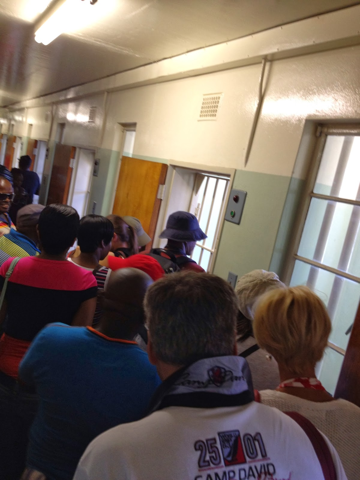 Robben Island - The crowd lines up to view Nelson Mandela's old prison cell
