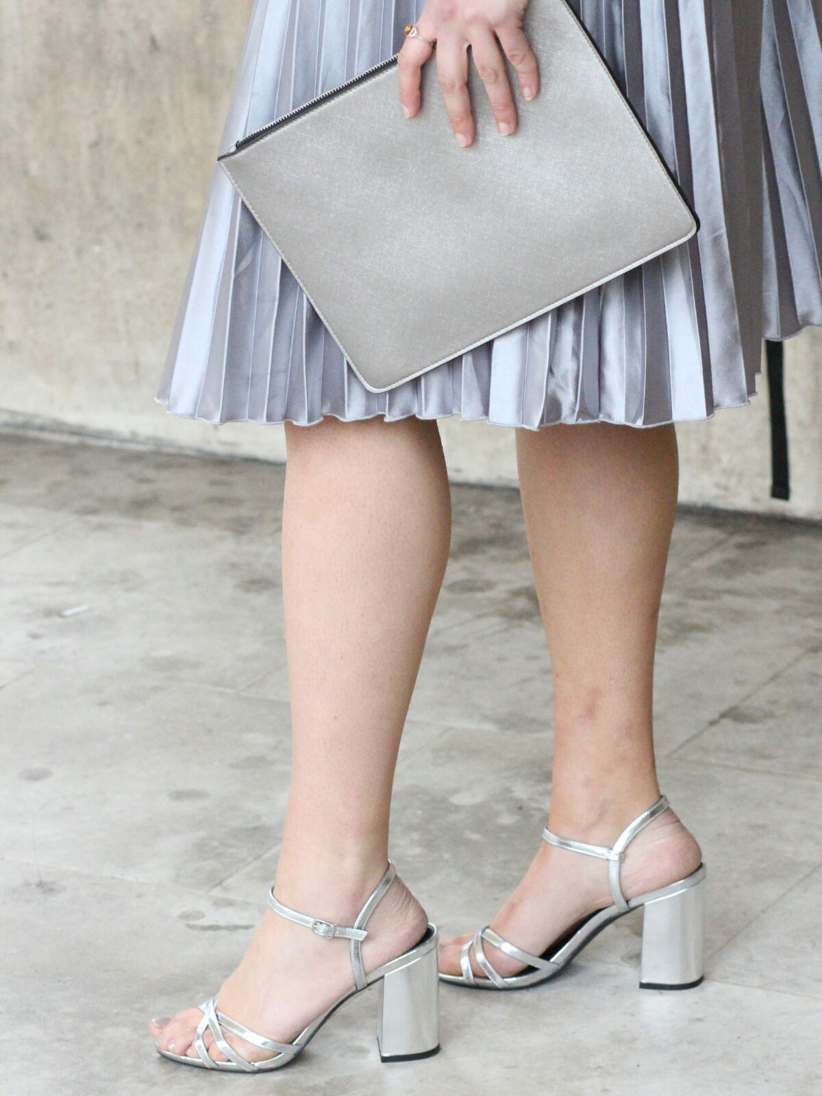 Close up of the silver H&M shoes and Metallic clutch