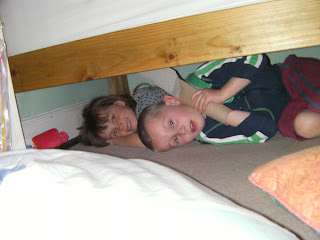 kids making den under bed