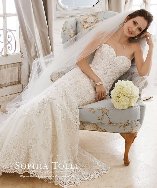 6eac41d568b Sophia Tolli Spring 2018 fit and flare bridal gown adorned with lightly  beaded lace
