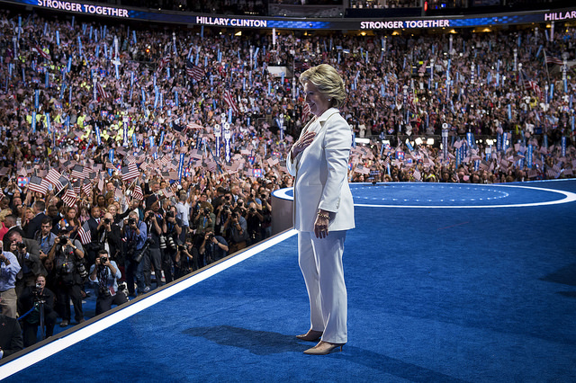 image of Hillary Clinton standing on stage at the Democratic Convention