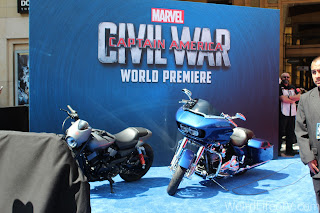 Captain America themed motorcycles on the blue carpet