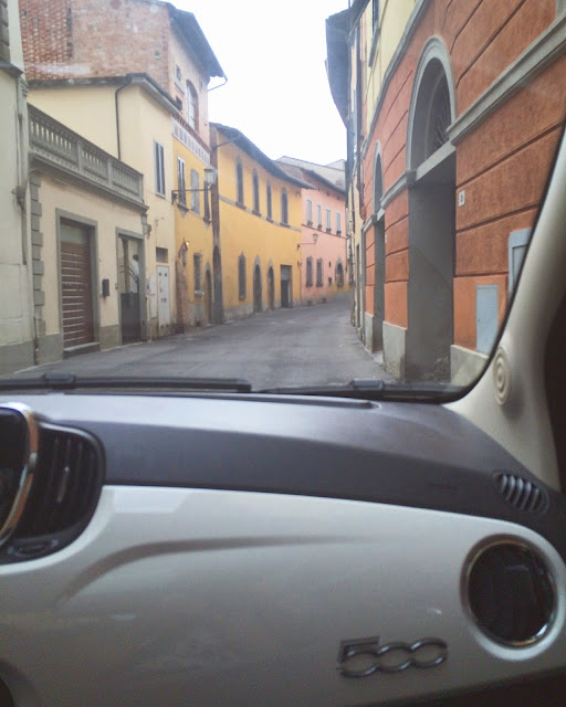 In Car View of Driving Through Streets of San Miniato in White Fiat 500
