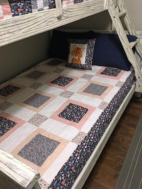 Deer fabric quilt with fox pillow