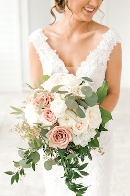 Bride in wedding gown with bouquet