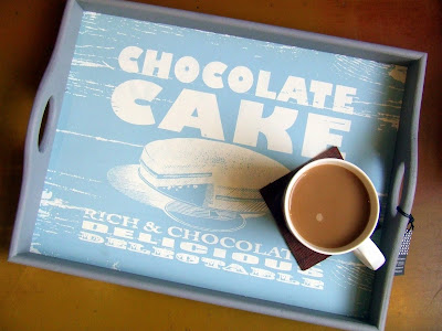 Wooden tray illustrated with chocolate cake