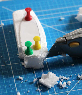 Carving the boat shape from polystyrene