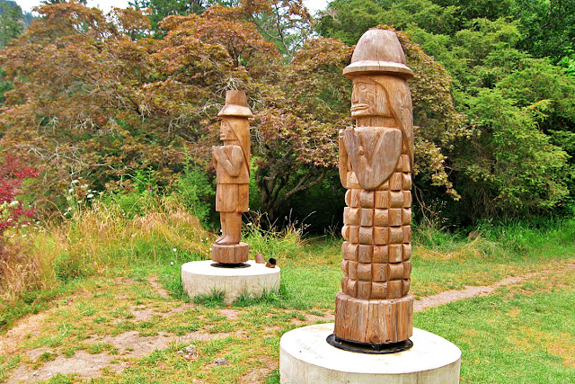 Native sculptures stand guard...
