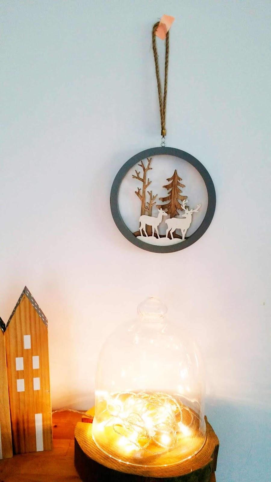 adorno navideño con ciervos
