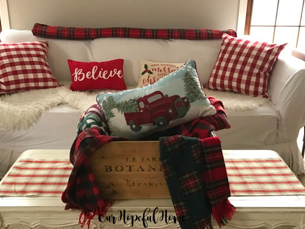 French crate with Christmas plaid scarves blankets