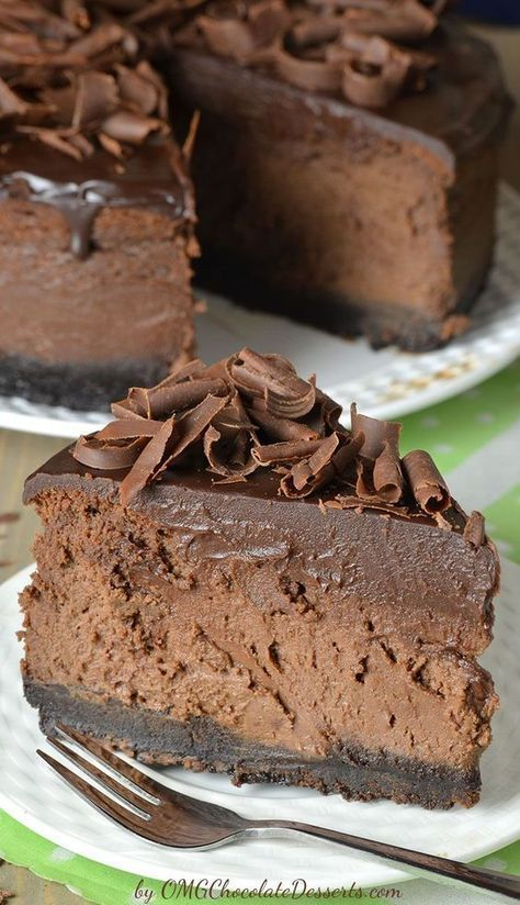 Bursting with chocolate flavor and smooth as silk, this Triple Chocolate Cheesecake with Oreo Crust is reach and decadent, triple chocolate treat. It's chocolate loves dream: chocolate cookie crust, smooth and creamy chocolate cheesecake filling, silky chocolate ganache topping, plus extra chocolate curls on top!!!